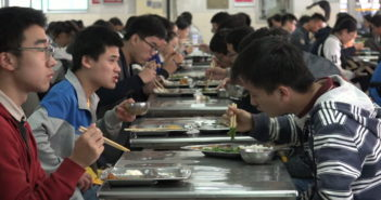 students eating at university canteen in china