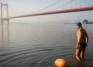 man entering the yangtze to swim in china