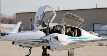 two people waving from small plane