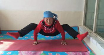 elderly woman practicing yoga at home