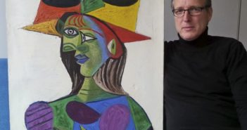 dutch art detective posing with recovered stolen picasso painting