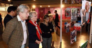 visitors looking at photos at exhibition on china in rome