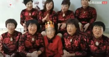old lady sitting in middle of daughters in happy birthday video