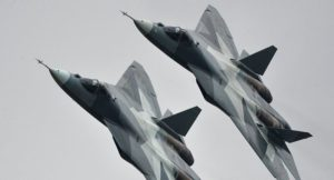 two su-57 fighter jets in the air