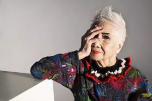 elderly woman posing for picture during fashion shoot