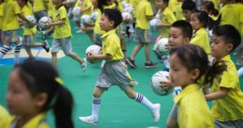 kindergarten students running with football in china