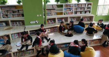 children reading at panda themed library in chengdu