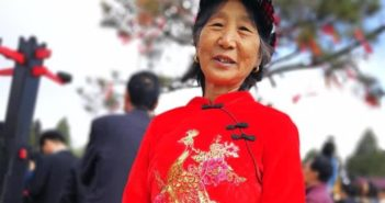 elderly chinese woman posing for picture