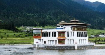 tibetan style building next to lake