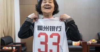 old lady holding a basketball shirt in china
