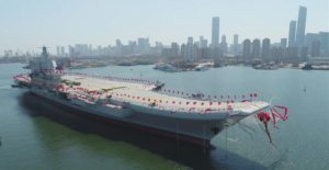 chinese aircraft carrier decorated with flags for event