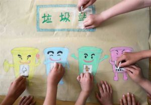 children's hands drawing rubbish sorting picture
