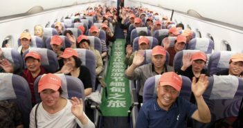 plane cabin full of chinese tourists