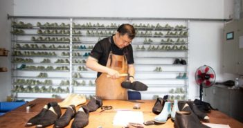 man making shoes in workshop