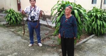 man holding elderly woman's long hair