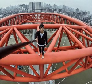 wu yongning filming video on top of bridge