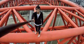 wu yongning filming video on top of bridge