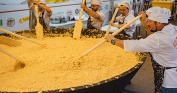 russian chefs cookig eggs in large pot