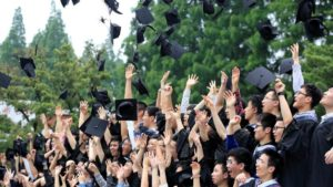 graduation students throwing hats in the air