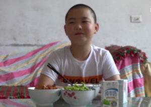 boy sitting at home with food