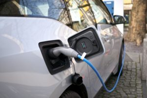 side view of electric car charging