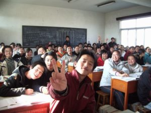 students posing for picture in classroom