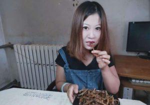 girl eating fried locusts