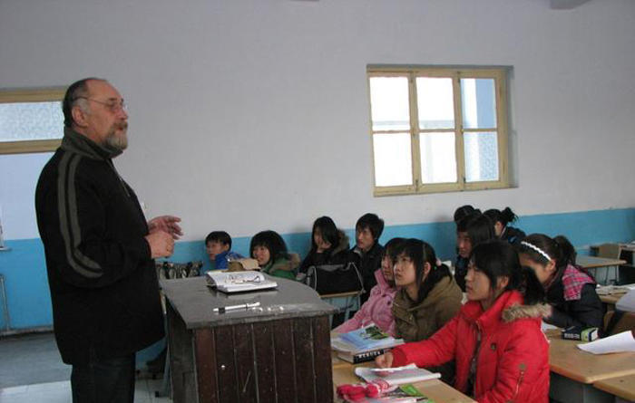 russian teacher in classroom with students