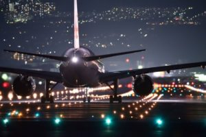 back view of plane on runway at night