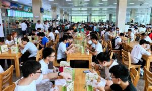 students eating in university dining hall