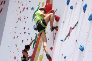 two athletes competing in climbing competition