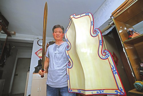 man holding replica weapons from qin dynasty period