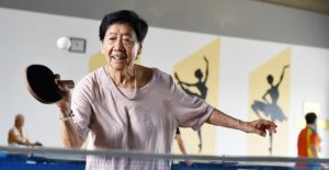 elderly lady playing table tennis