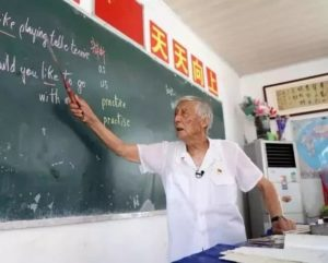 elderly teacher in classroom teaching english