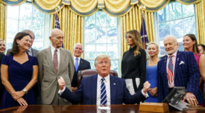 Buzz Aldrin and Michael Collins with president trump in oval office