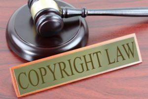 judges hammer next to copyright law sign