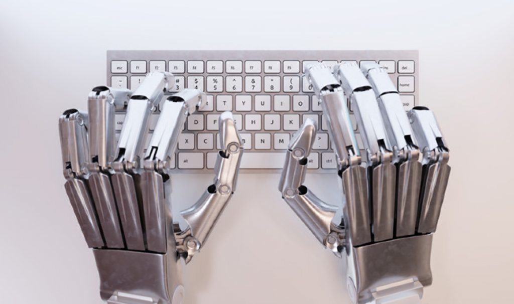 top view of robot hands typing on keyboard