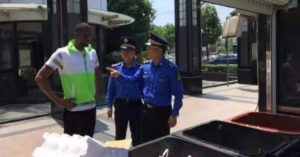 police and foreigner next to rubbish sorting bins in shanghai