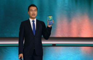 man holding Huawei Mate 20 X (5G)