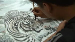man painting a tiger