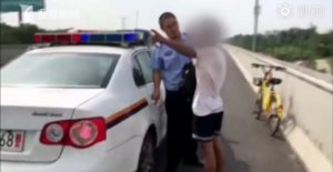 policeman talking to man on highway in china