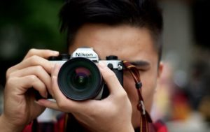 asian man holding camera