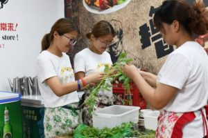 three woman preparing vegetables