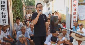 man singing in village