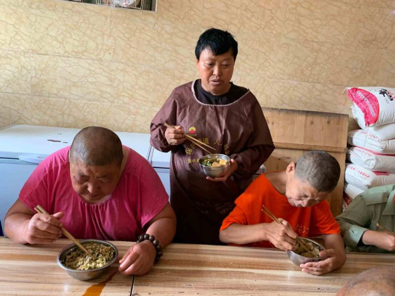three people eating