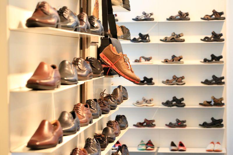 shoes of shelves at shoe shop