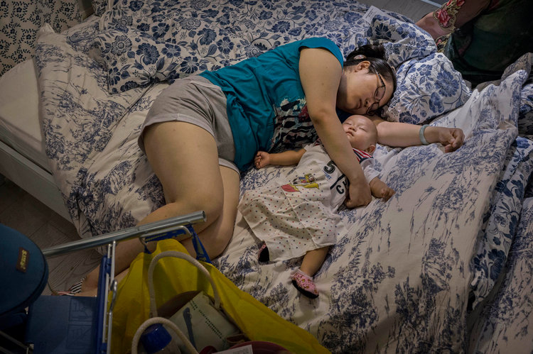mother and baby sleeping on bed at IKEA