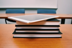 tablet device on top of books