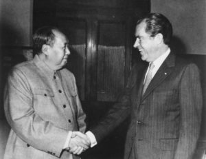richard nixon shaking hands with chairman mao