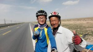 two cyclists posing for picture